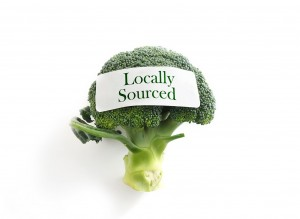 Fresh broccoli on white with Locally Sourced label